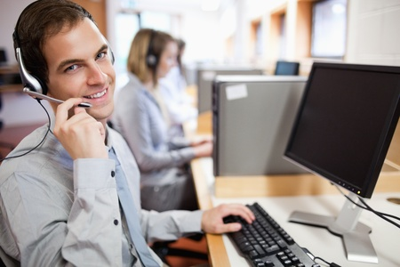 personal call: Assistant using a headset in a call center Stock Photo