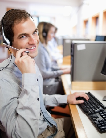 Portrait of an assistant using a headset in a call center Stock Photo - 11184100