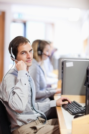 Portrait of a customer assistant using a headset in a call center photo