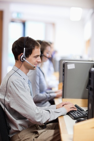 personal call: Portrait of a customer assistant working in a call center