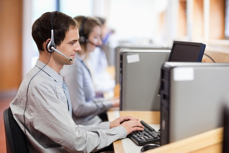 Customer assistant working in a call center photo