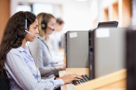 Customer assistant working with a computer in call center Stock Photo - 11183713
