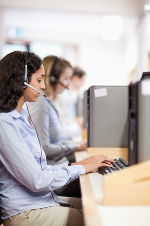 Portrait of a customer assistant working with a computer in a call center Stock Photo - 11184105