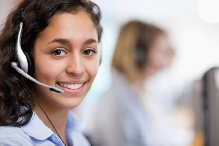 Close up of a customer assistant wearing a headset photo