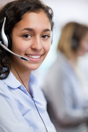 Portrait of a customer assistant wearing a headset photo