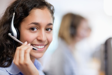 Close up of a smiling customer assistant wearing a headset photo