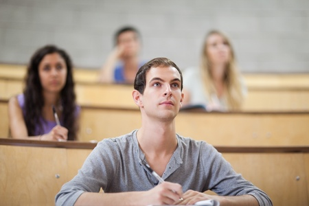 Students listening during a lecture in an amphitheater photo
