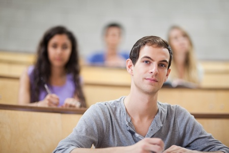 freshmen: Young students listening during a lecture with the camera focus on the foreground