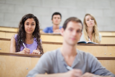 Focused students listening during a lecture in an amphitheater photo