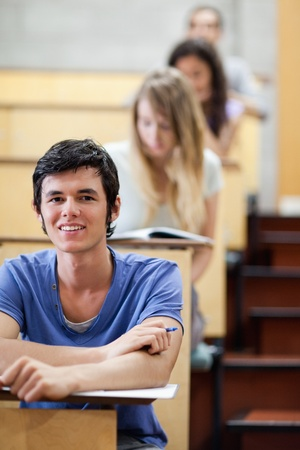 Portrait of a young student during examination in an amphitheater photo