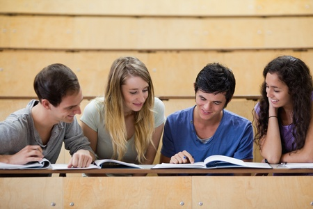 Students working together in an amphitheater photo