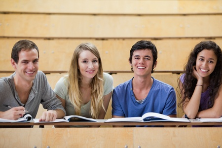 Smiling students working together in an amphitheater photo