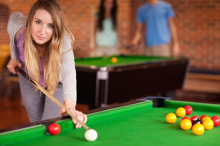 poolball: Cute woman playing snooker in a home student