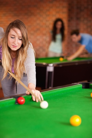 poolball: Portrait of a cute woman playing snooker in a home student Stock Photo