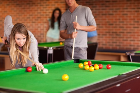 snooker table: Friends playing snooker in a student home Stock Photo