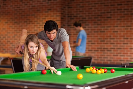 billiards tables: Couple playing snooker in a student home