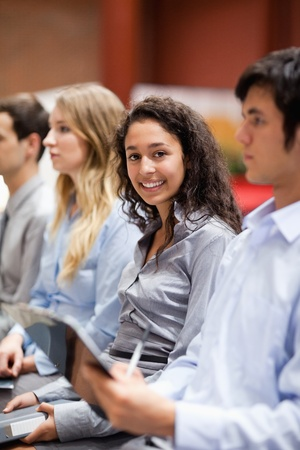 four classes: Portrait of a businesswoman smiling at the camera during a presentation Stock Photo