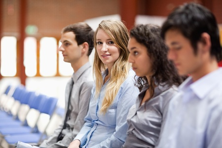 Young businesswoman smiling at the camera during a presentation photo