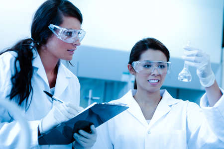 sterile: Lab partners doing an experiment in a laboratory Stock Photo