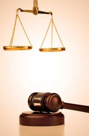 trial balance: Fixed gavel and scale of justice on a white background Stock Photo