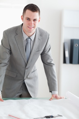 Close up of smiling architect behind a table Stock Photo - 11619380
