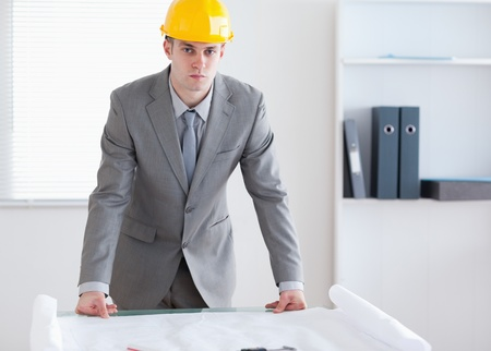 Serious looking architect with helmet on Stock Photo - 11610417