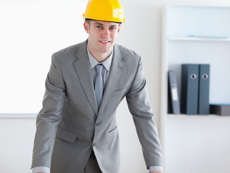 Standing and smiling architect with helmet on Stock Photo - 11619482