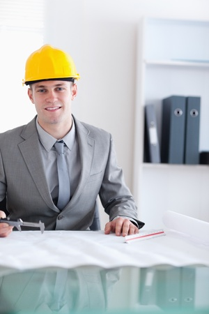 Close up of smiling architect behind a table working on a plan Stock Photo - 11620070