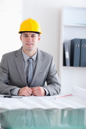 Close up of a working architect behind a table Stock Photo - 11620373