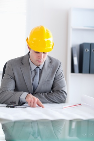 Close up of an architect behind a table checking a plan Stock Photo - 11620046