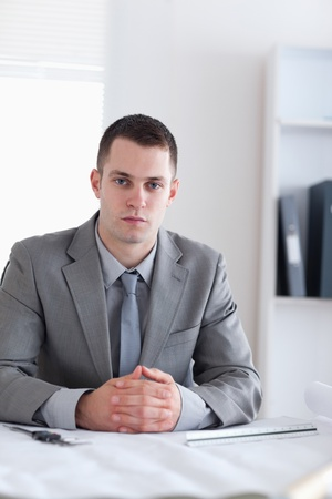 Close up of architect sitting behind a table with his hands folded Stock Photo - 11620153