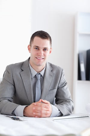 Close up of smiling architect with folded hands Stock Photo - 11619658