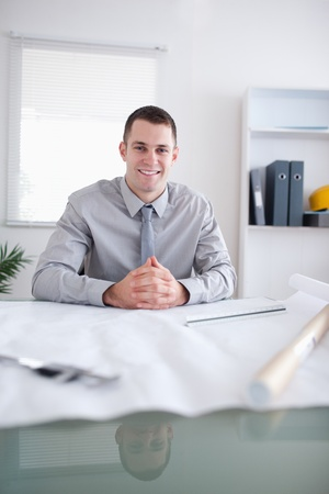 Close up of architect smiling and sitting behind a table Stock Photo - 11619898