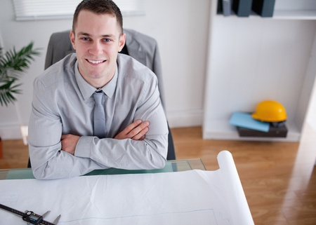 Close up of architect with folded arms sitting behind a table Stock Photo - 11620463