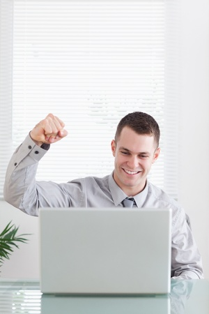 Close up of young businessman happy about an email Stock Photo