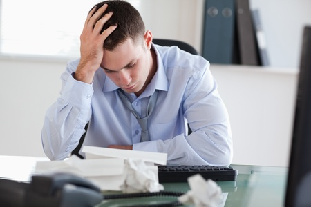 Close up of businessman getting frustrated with paperwork photo