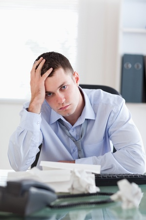 Close up of frustrated businessman being unhappy about accounting photo