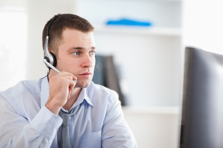 service center: Young call center agent speaking with costumer