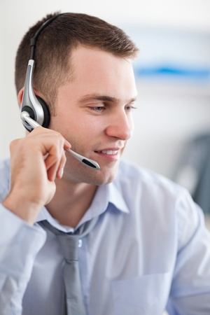 costumers: Close up of young call center agent solving a costumers problem