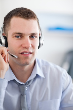 Close up call center agent listening to costumer carefully