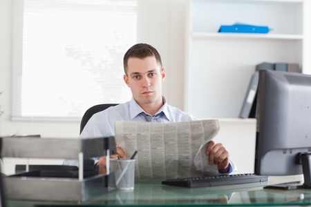 Young businessman reading the news photo