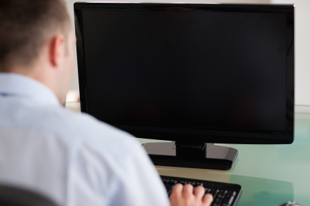 computer age: Close up of young businessman being shadowed