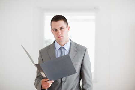 Young businessman with open folder Stock Photo