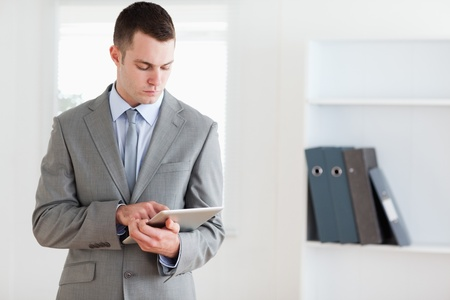 Businessman reading his notes carefully Stock Photo