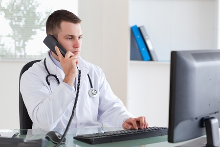 Young doctor on the telephone photo