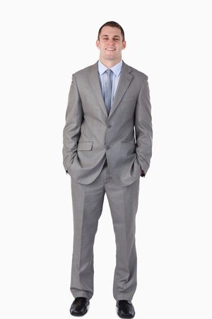 Smiling businessman with hands in his pocket on white background Stock Photo