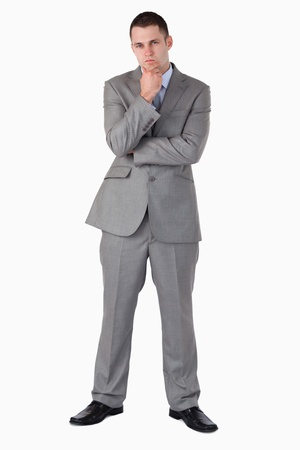Businessman in thoughts on white background