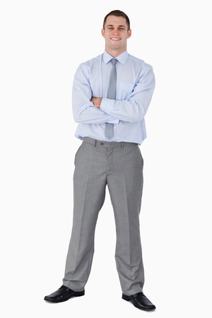Happy businessman with his arms folded on white background