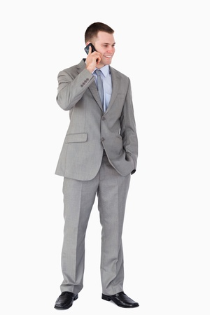 Businessman standing and phoning on white background Stock Photo