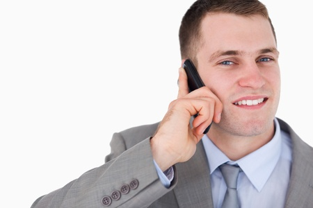 close up of businessman looking up while on the cellphone on white background